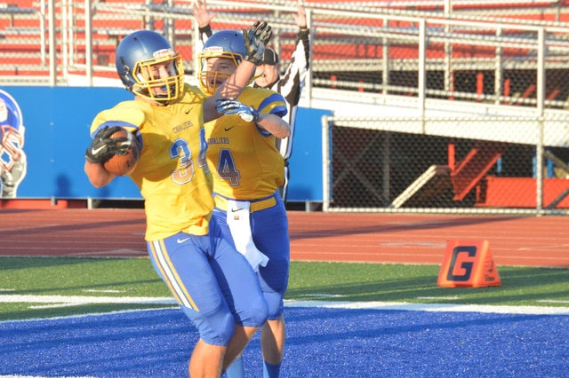 Rob Kiser/Call Photo Lehman's Jacob Earhart celebrates a touchdown with teammate Jared Rourke Saturday night.