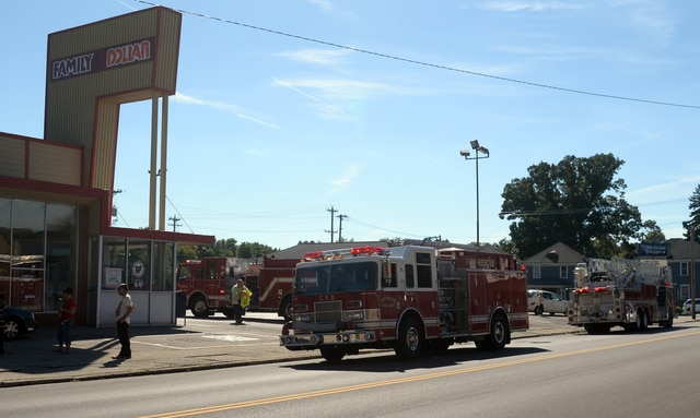 Fire units from Piqua and Covington check out a report of smoke in the building at the High Street Family Dollar store on Tuesday afternoon.