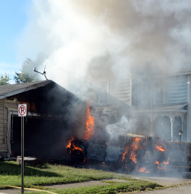 Mike Ullery | Daily Call An SUV fire at 328 South Street in Piqua destroyed the vehicle and damaged two nearby homes on Tuesday afternoon.