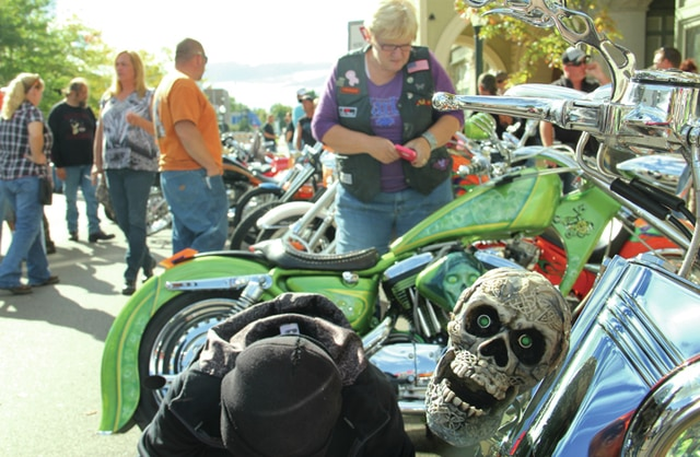 Spectators vote on their favorite bike during the Thunder Zone Bike Show contest at Piqua BikeFest on Saturday.