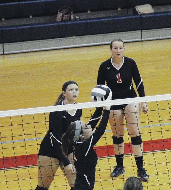 Rob Kiser/Call Photo Cassidy Sullenberger sets the ball against Emmanuel Christian as Carly Brown and Kyla Blankenship look on.