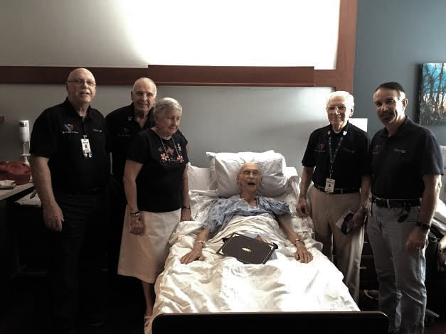 "Hospice of Miami County, ""We Honor Veterans"" volunteers had the privilege to pin World War II Naval aviator, John Headapohl. From left, Wayne Melgaard, Larry Blackmore, Mareta Headapohl, John's wife, honoree, John Headapohl, Bill Sharp, and Bob Allen."