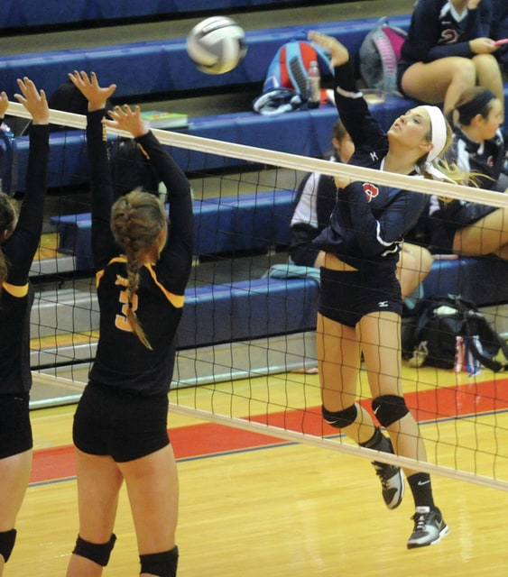 Mike Ullery   Daily Call Piqua's Ashley Brading, 6, goes for a kill shot.