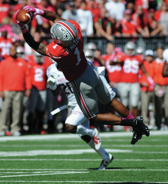 Ohio State's Braxton Miller, 1, makes a leaping catch for a Buckeye first down.