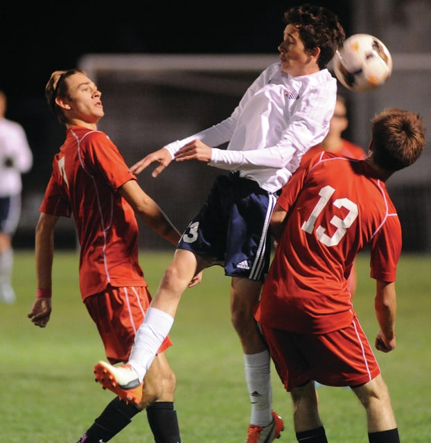 Mike Ullery | Daily Call Kaden Jones, 13, fights off a double-team to keep control of the ball for Piqua.