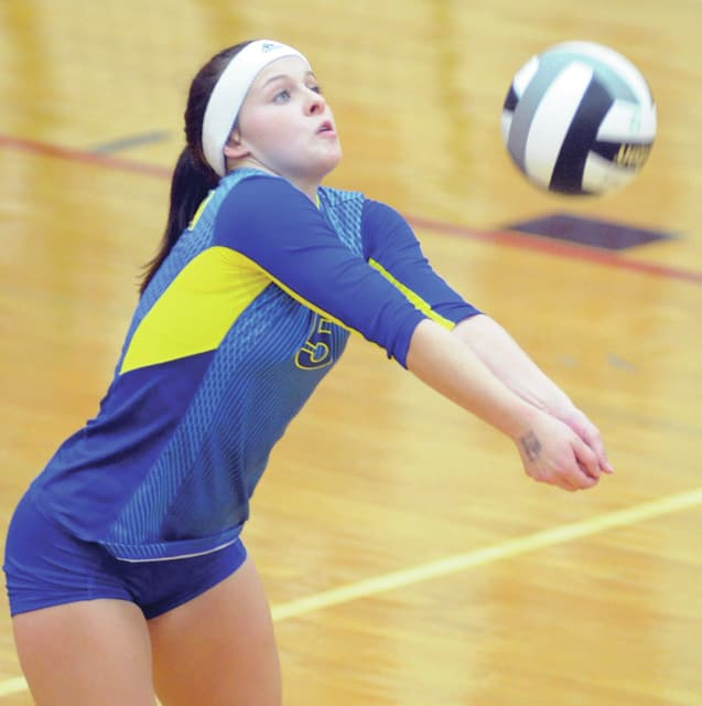 Mike Ullery/Daily Call Madison Hussey passes the ball for Lehman Saturday.