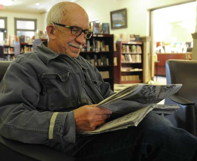Mike Ullery | Daily Call Tom Nemeo of Piqua reads the paper in the lobby of the Piqua Public Library. The library offers numerous free options to older patrons through its popular outreach services program.