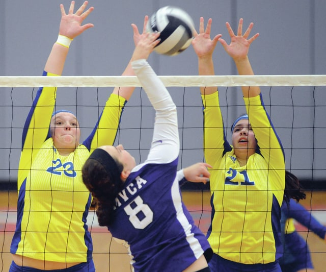 Mike Ullery | Daily Call Allie Hall, 23, and Madie McFarland, 21, go for a block.