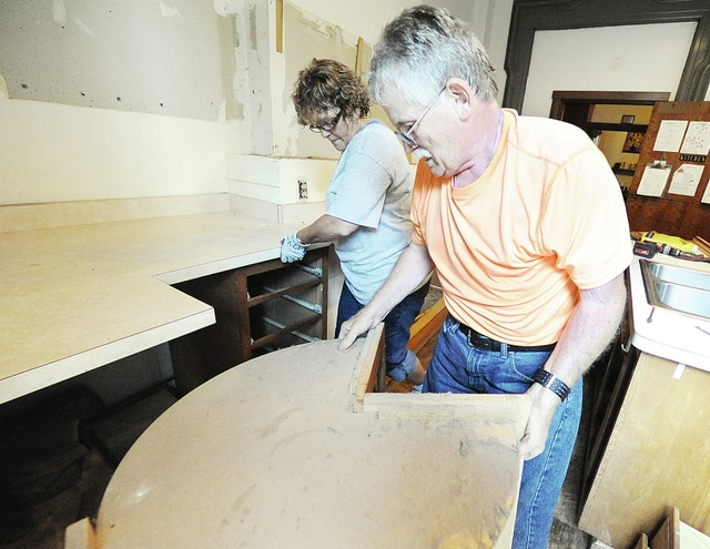 Anthony Weber | Troy Daily News Representatives from Home Depot from Piqua including Terry Lewis and Cindy Boram help in remodeling the kitchen at the Family Abuse Shelter of Miami County Wednesday, August 27, 2014, in Troy. The structure officially became the Franklin House in 1975.