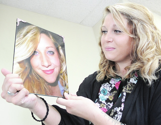 Anthony Weber | Troy Daily News Molly Jarvis holds a portrait of her sister, Erin, who lost her life to an addiction to heroin recently. Molly is now promoting an EKJ Walk against Heroin in her sister's honor and to raise awareness of heroin addiction.
