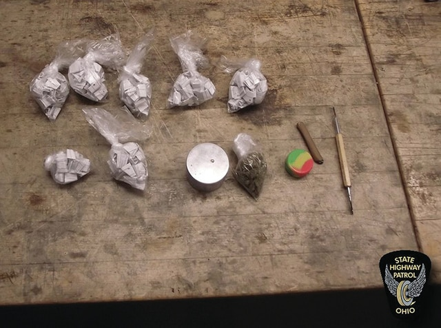 During interaction with the driver, troopers detected an odor of raw marijuana. A probable cause search of the vehicle reportedly revealed a small amount of marijuana, hash, and seven plastic baggies containing individually wrapped packages of heroin worth $5,250.