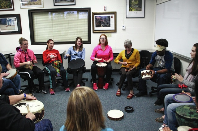 Provided photo Edison students in Gail Ahmed's music appreciation class gather in a drum circle to participate in HealthRHYTHMS. Drumming Circle