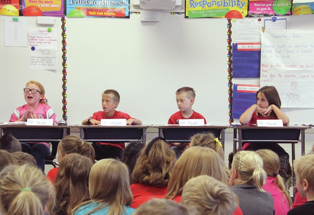 Amy Barger | Daily Call K-Kids officers Paige Croslin, president, Braden Holtvogt, vice president, Glen Nickels, secretary, and Madison Reeves, treasurer, conduct their first meeting on Friday at Washington Primary School.