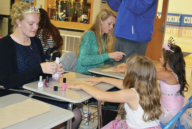 Kelsey Kirchner, left, and Liza Bair, center, paint the nails of two princesses during the Princess for a Day event at Miami East High School on Saturday. The event raised $600 to go toward the March of Dimes for research to prevent premature babies and produce healthier pregnancies.