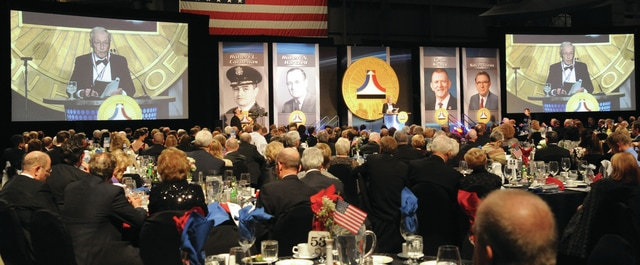Mike Ullery | Daily Call Thomas Hartzell gives his acceptance speech, on behalf of his father, Robert N. Hartzell, during enshrinement ceremonies for the National Aviation Hall of Fame Class of 2015, last Friday at the National Museum of the United States Air Force.