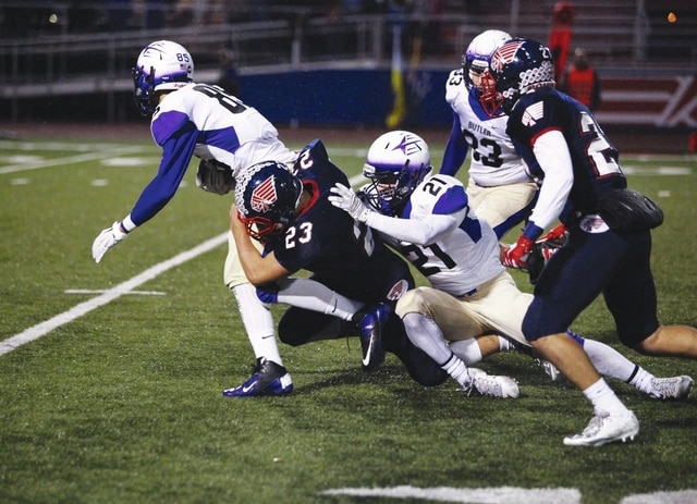 Tom Lillicrap/Daily Call Piqua linebacker Ben Schmiesing makes a tackle against Vandalia-Butler last week.