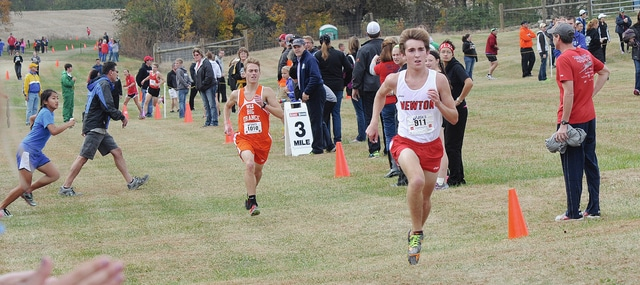Rob Kiser/Daily Call Newton's Brady McBride pulls away from West Liberty-Salem's Joey Adams to win the D-III boys race.