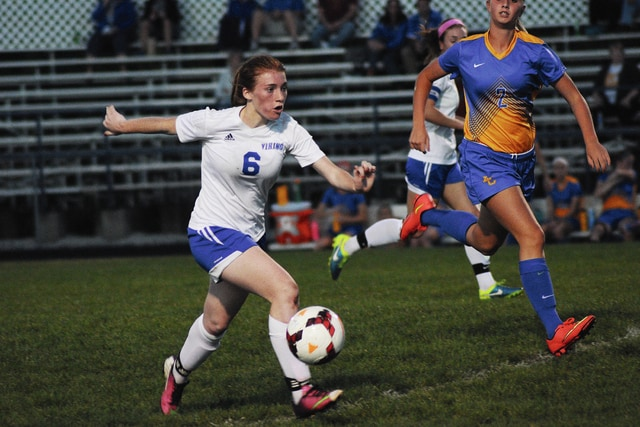Rob Kiser/Call Photo Miami East's Danielle Mannier dribbles the ball up the field against Lehman's Carly Edwards.