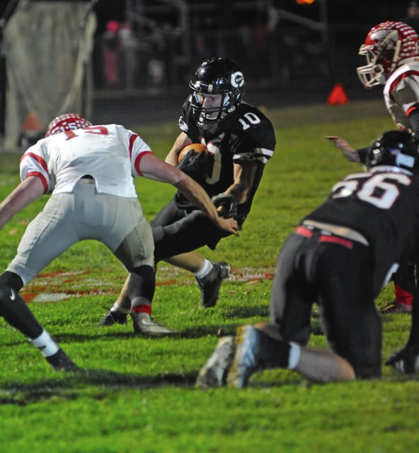 Ben Robinson/GoBuccs.com Covington's Jared Williams eludes tacklers on his way to the end zone Friday night.