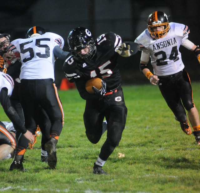Ben Robinson/GoBuccs.com Lance Miller finds running room for Covington Friday against Ansonia.