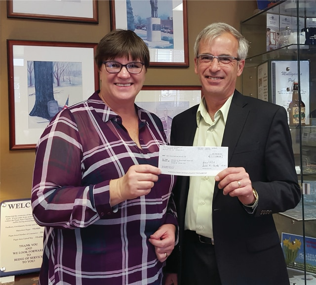 Provided photo Tom Walter of Walter Agencies, Inc., of Allstate, recently presented Lorna Swisher, executive director of Mainstreet Piqua, with a $1,000 check from The Allstate Foundation. The grant was made to Friends of Mainstreet Piqua because of the volunteerism provided by Walter and employees of his agency on Caldwell Street. The Allstate Foundation has donated more than $400 million in funding across the country to address key social efforts.