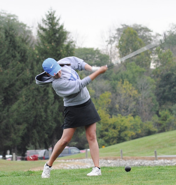 Rob Kiser/Call Photo Miami East's Maggie Bergman hits her tee shot on the third hole Wednesday at Stillwater Valley Golf Course.