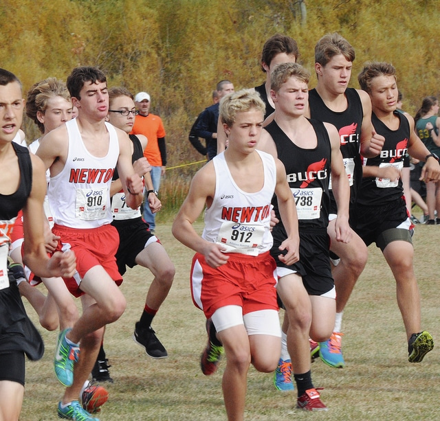 Rob Kiser/Call Photo Newton's Atley King (910), Ryan Mollette (912) and Covington's Jared Ford (738) lead a group of runners at the district meet. Covington and Newton will both compete in the regional Saturday.