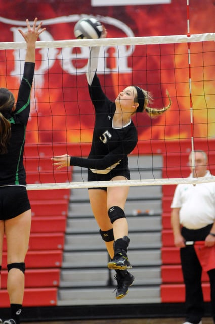 Ben Robinson/GoBuccs.com Rachel York hits the ball for Covington Tuesday night.