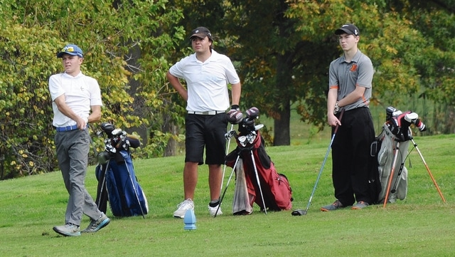 Rob Kiser/Call Photo Lehman's Tyler Lachat hits a tee shot as Miami Valley's Troy Bradshaw and Bradford's Alex Swabb look on.
