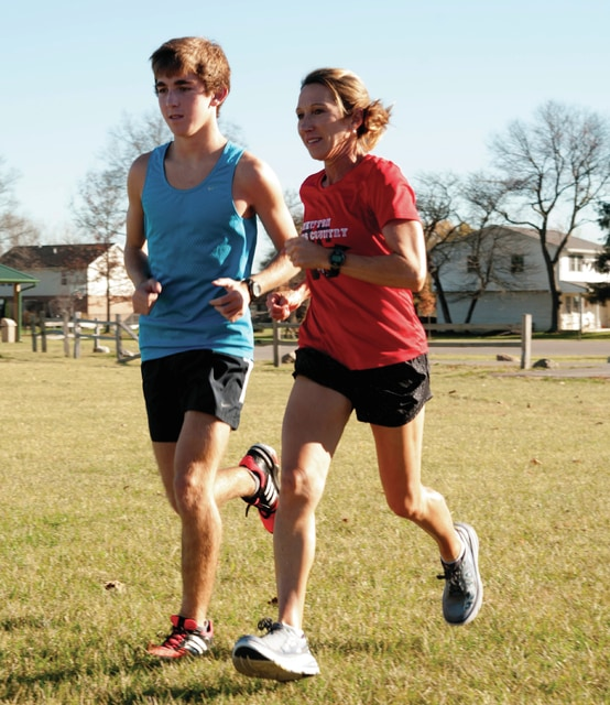 Mike Ullery/Daily Call Newton's senior Brady McBride and his mother/coach Tiffany McBride run at practice this week. McBride won the district and regional titles and will run at the state meet Saturday.