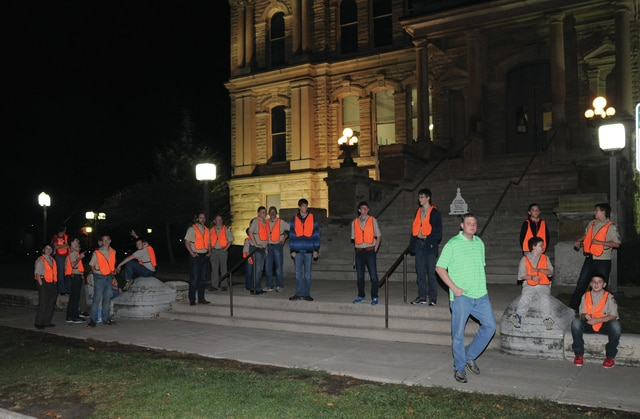 Mike Ullery | Daily Call Boys Scouts from Troop 395 in Tipp City wait outside the Miami County Courthouse on Tuesday evening for poll workers to begin delivering ballots.