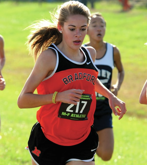 Mike Ullery | Daily Call Karmen Knepp, 217, of Bradford stays at the front of the pack during Saturday's girls' Division III state cross country race in Hebron.