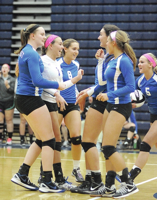 Anthony Weber/Troy Daily News file Miami East's volleyball team celebrates a winning a point during its regional semfiinal match against Anna last week. The Vikings will play in the Division III state semifinal match Thursday at the Nutter Center.