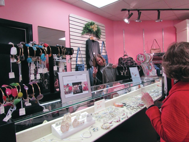 Beth Kazer behind the counter in the ladies boutique at Barclay's during the Piqua Holiday Open House on Saturday.