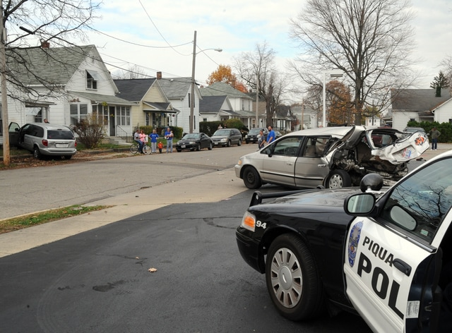Mike Ullery   Daily Call Piqua police investigate Thursday's crash at Shell on South Street.
