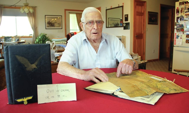 World War II Veteran Marion Adams, 92, of Covington, shares his war memorabilia that he collected while he served. He was a first class radio operator and mail orderly on his ship LST 491 during the war.