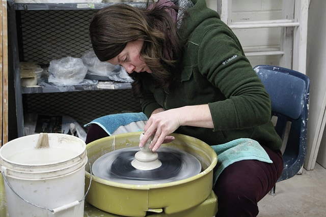Provided photo Stephanie Beiser, adjunct professor of ceramics at Edison State Community College, throws a ceramic piece on the potter's wheel. Edison will be selling handmade ceramic pieces, glass gifts, and jewelry on Dec. 1 and Dec. 3 to raise funds for the ceramics department.