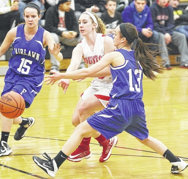 Call File Photo Macey Stang splits two Fairlawn defenders last year.