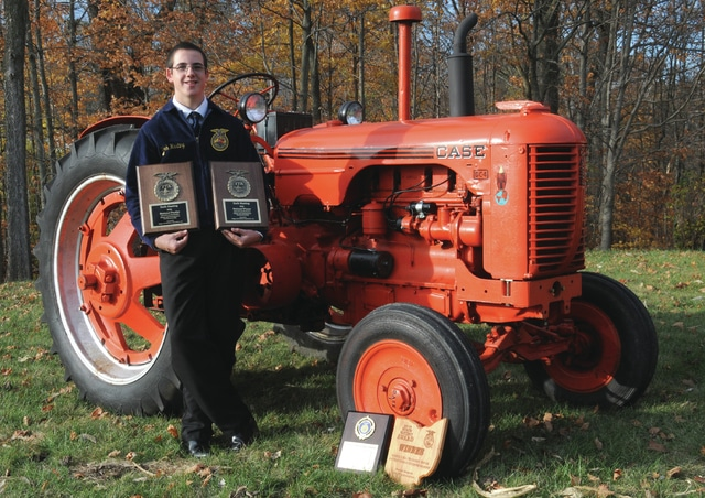 Covington FFA senior Zach Hasting stands with a 1951 CASE Model DC4 tractor that he completely restored and placed first in the National FFA Conference in agricultural mechanics repair and maintenance entrepreneurship last weekend.
