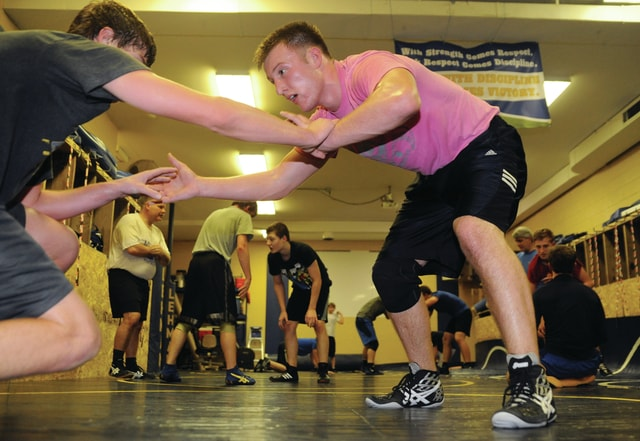 Mike Ullery | Daily Call Collin Haller, left, and Wyatt Long, right, work on takedown drills during Lehman High School wrestling practice on Tuesday. Haller is expected to wrestle in the 160 pound weight class for the Cavs, with Long at 182.
