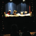 Christmas puppets visit library