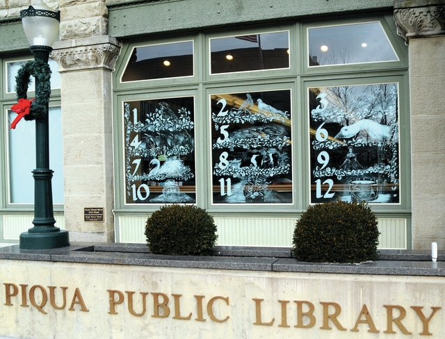 Mike Ullery   Daily Call Windows at the Piqua Public Library depict the <em>Twelve Days of Christmas</em>, the library's 2015 theme for the Christmas season. The artwork was done by Michael Glass of Greenville.