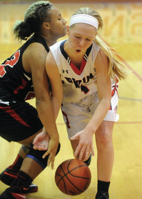 Mike Ullery | Daily Call Lauren Williams, 1, drives to the basket for Piqua.