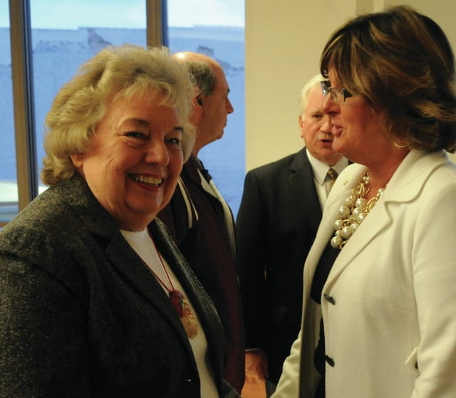 Mike Ullery   Daily Call Mayor Lucy Fess, smiles as she talks with Kathy Sherman during a reception on Tuesday at the Piqua city commission chambers.