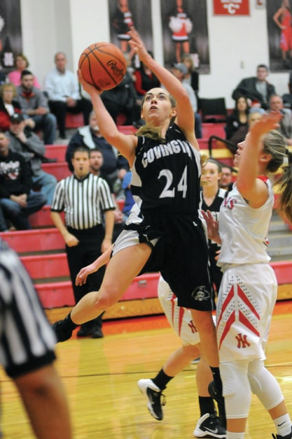 Ben Robinson/GoBuccs.com file Covington's Sammi Whiteman drives to the basket Tuesday against Newton.