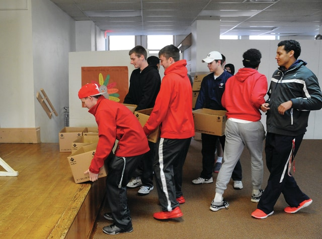 Mike Ullery | Daily Call Members of the Piqua boys basketball team deliver canned goods to the Greene Street United Methodist Church food pantry on Saturday. The team collected more than 500 donations from fans attending Friday's game against Sidney.