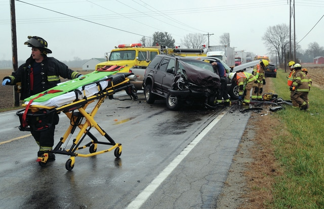 Mike Ullery | Daily Call Emergency crews work at the scene of a head-on crash involving a pickup truck and and SUV on East US Rt. 36 on Monday afternoon.