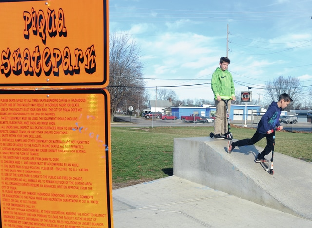 Mike Ullery | Daily Call As Christmas Eve temperatures near the 60 degree mark, Ehtan Acel, 13, and Kadyn Schemmel, 9, both of Piqua, take advantage of the warm weather to spend some time at the Piqua Skatepark.