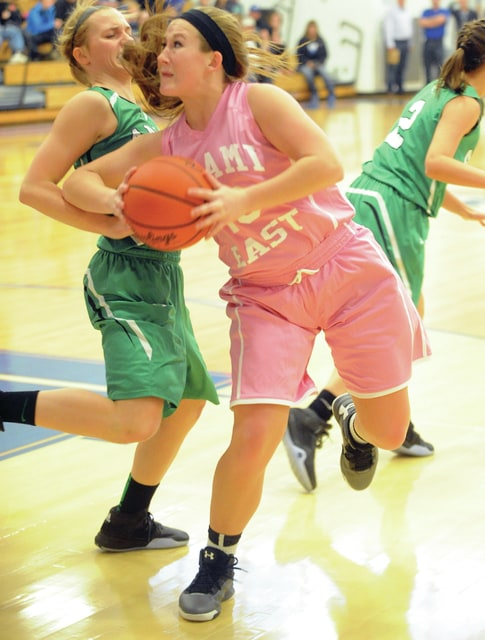 Mike Ullery | Civitas Media Miami East's Megan Thompson (10) fights her way to the basket against Anna Saturday.