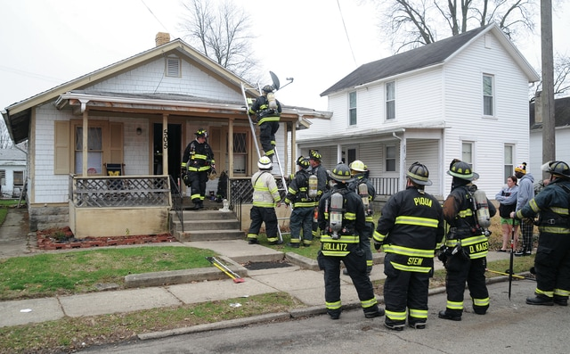 Mike Ullery | Daily Call Firefighters from Piqua and Covington investigate a reported house fire at 505 Kitt Street in Piqua on Saturday morning.